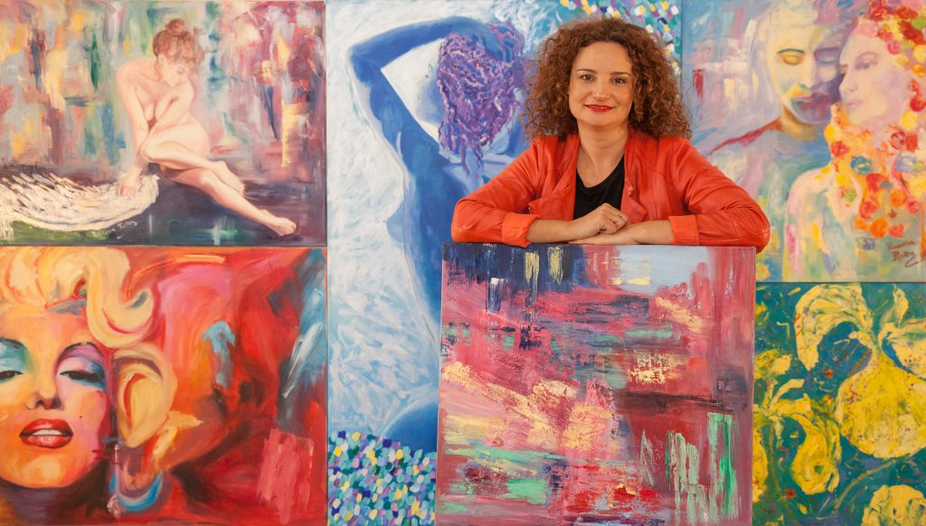 Ramona Pintea stands with artwork for your home